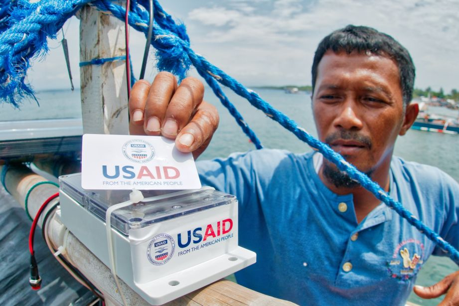 A man using a traceability system from USAID