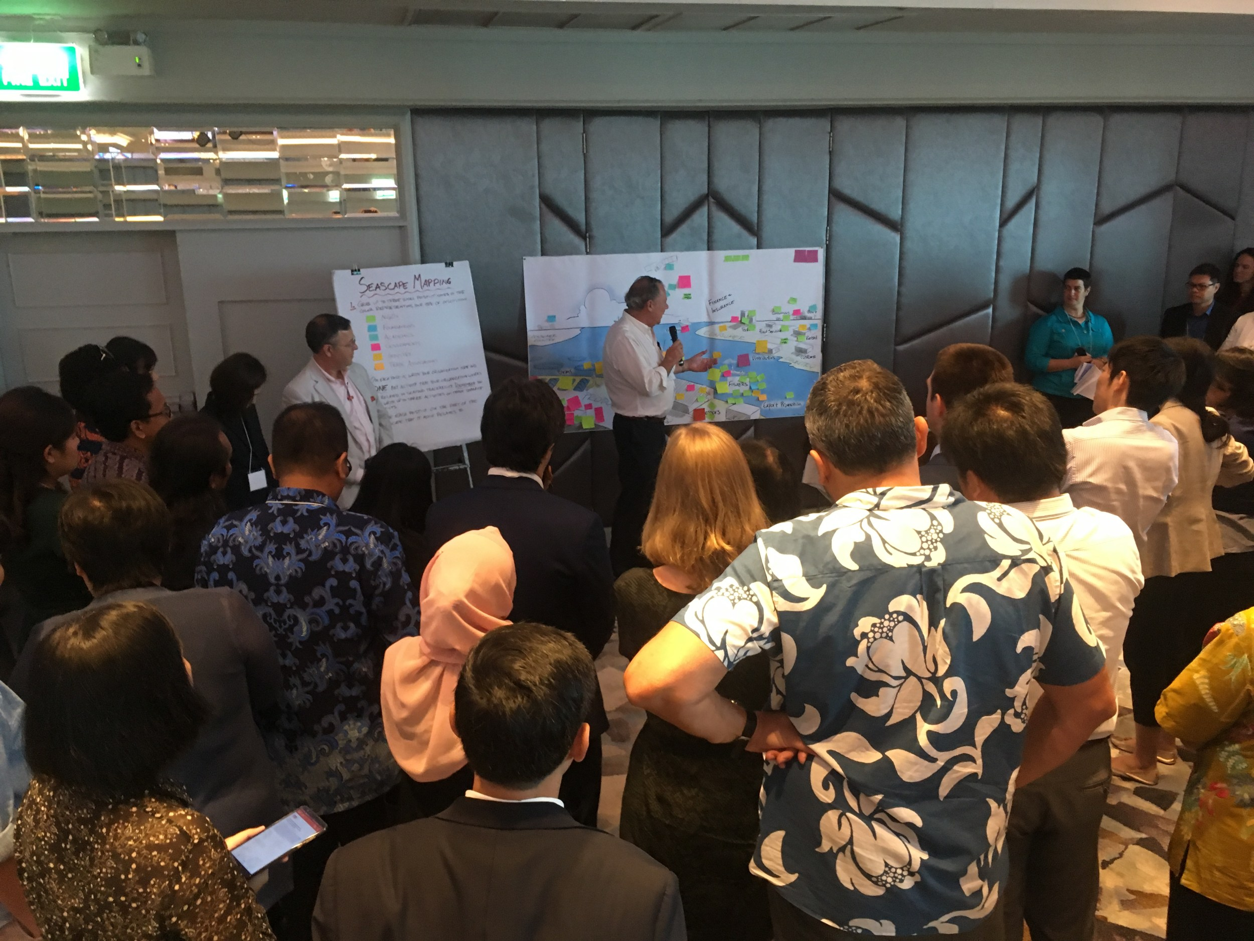 Participants at SALT's Datalab look at a drawing of the traceability seascape to discuss seascape mapping
