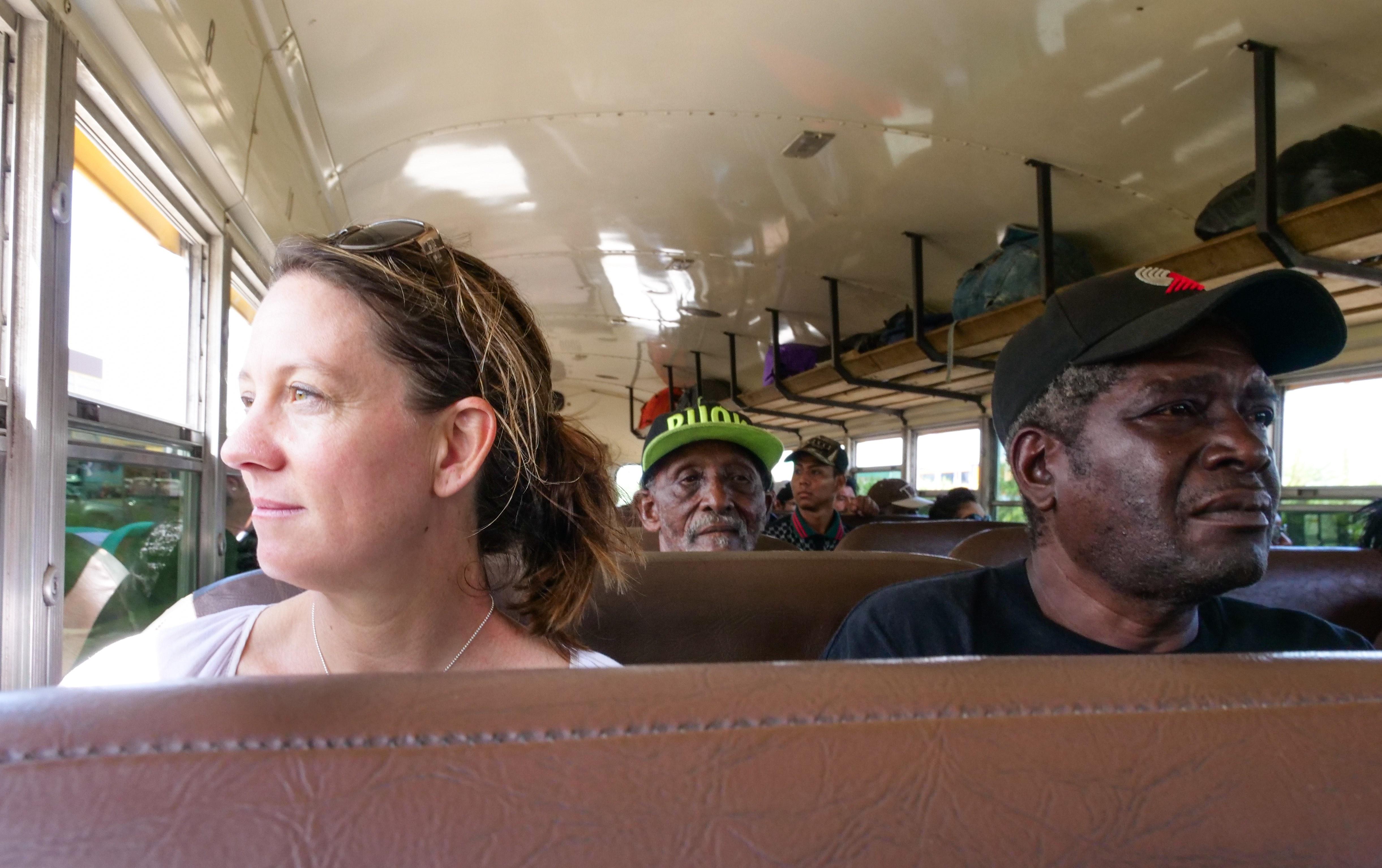 Salt staff member Amy West sits inside a bus.