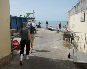 SALT staff Amy West follows lobster fishery workers outside the plant.