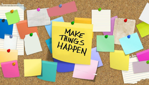 a bulletin board of sticky notes that says Make Things Happen