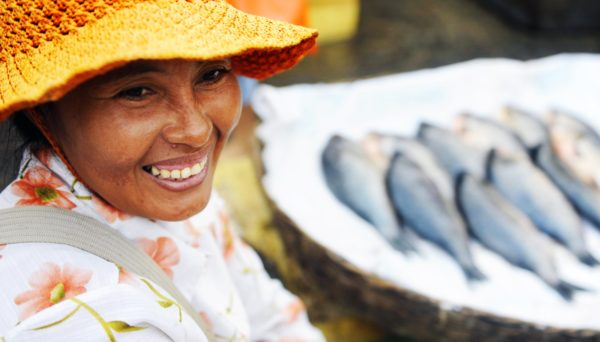 lady in front of fish at market