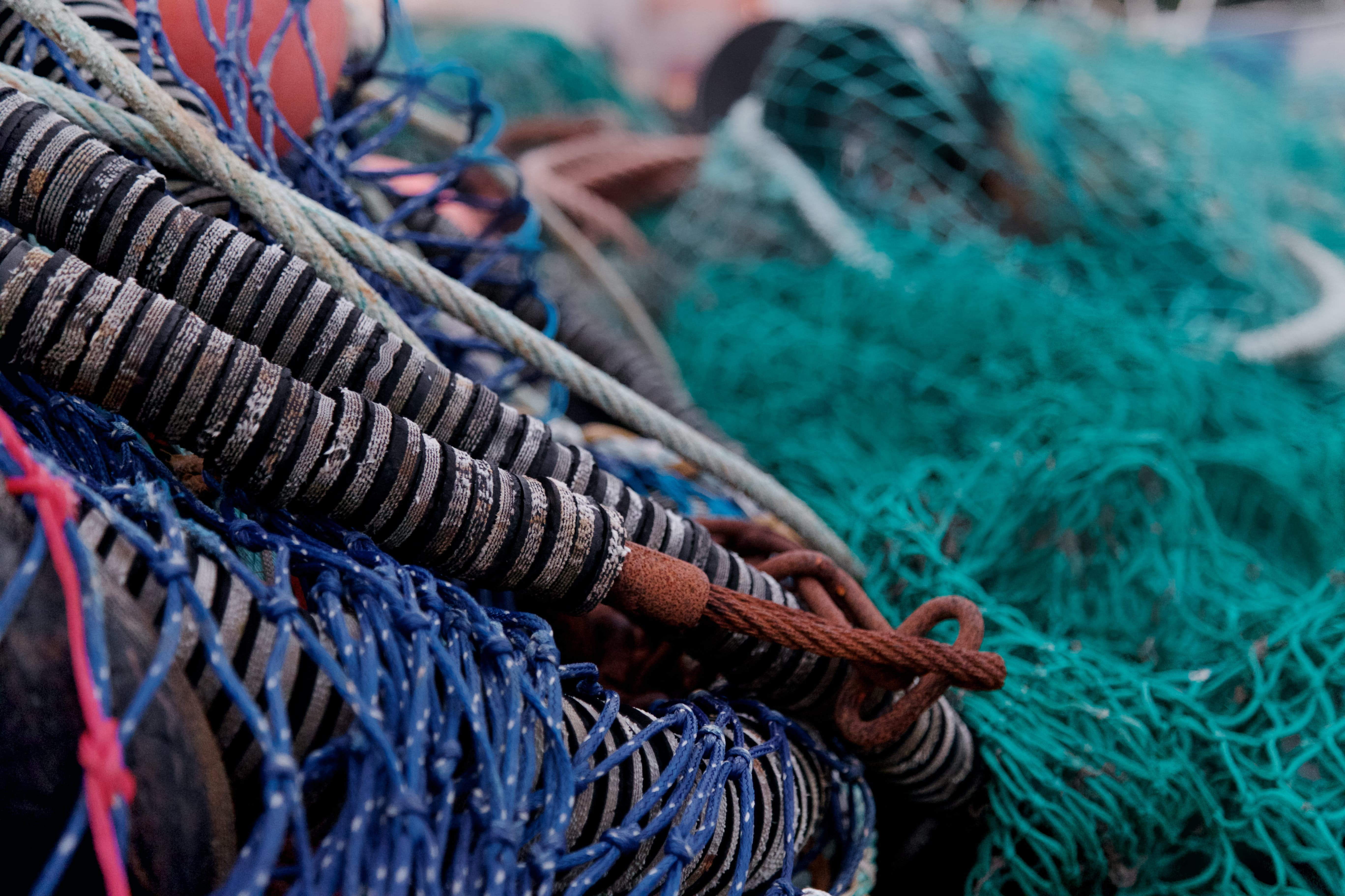 Various fishing nets in a pile