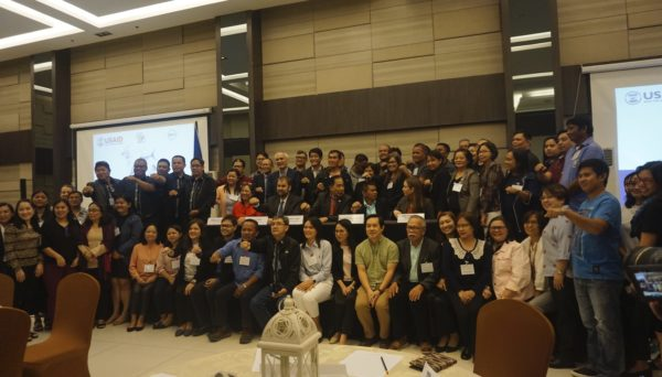 Photo of dozens of stakeholders at USAID Oceans Close-out Event in Manila, Philippines